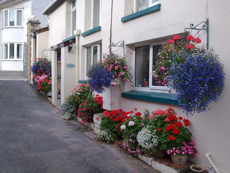 Outside the property - beautiful in bloom. Ground Floor apartment
