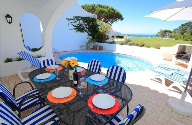 Lovely outside dining terrace with pool and stunning views across the golf course to the ocean