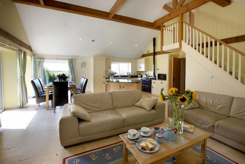 Huge, bright, light open living/dining area with vaulted ceiling, great views across the countryside