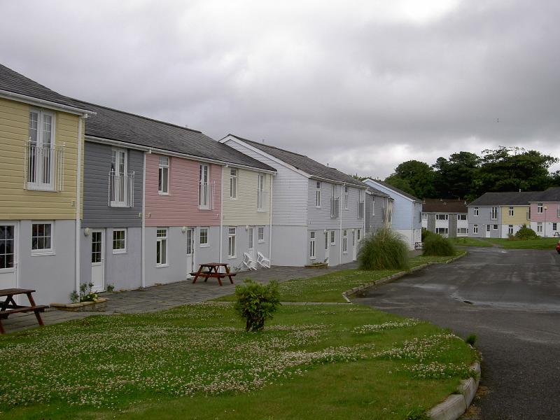 Pink  house and parking areas with plent of space to spread out