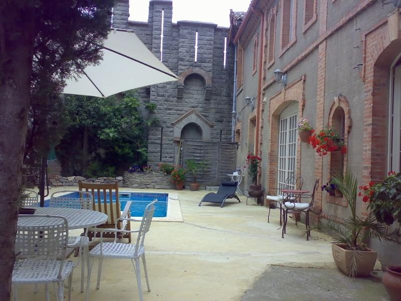 Chateau's walled courtyard provides maximum privacy for swimming and sunbathing.
