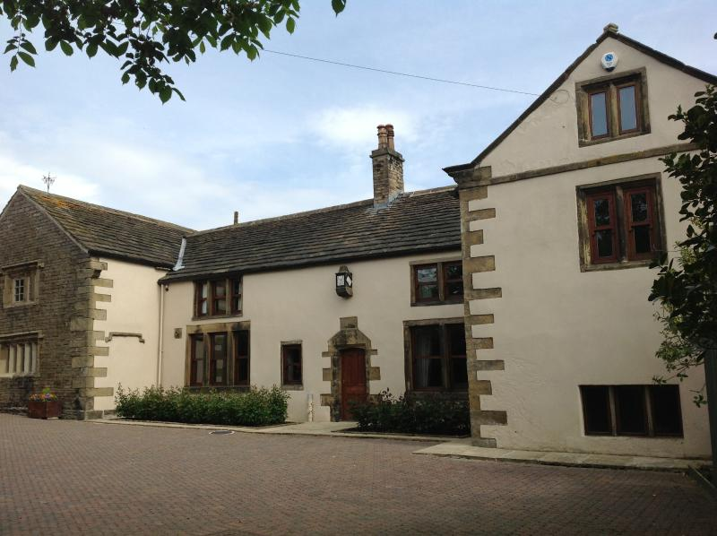Front of The Grange with ample secure private parking and spacious  courtyard for children to play
