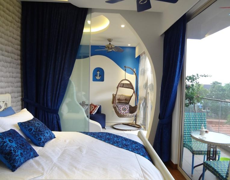 The Greek suite is a two-bedroom apartment painted in calming hues of blue and white.