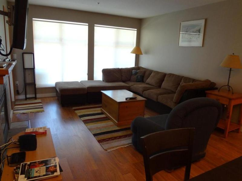 Cozy living room with laminate floor and flat screen TV - perfect for video nights