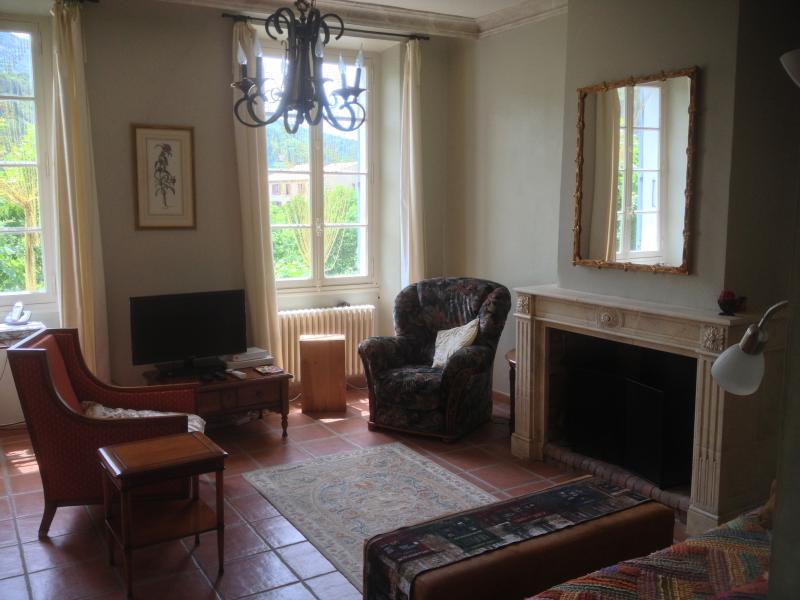 Living room with TV and comfy chairs & couch