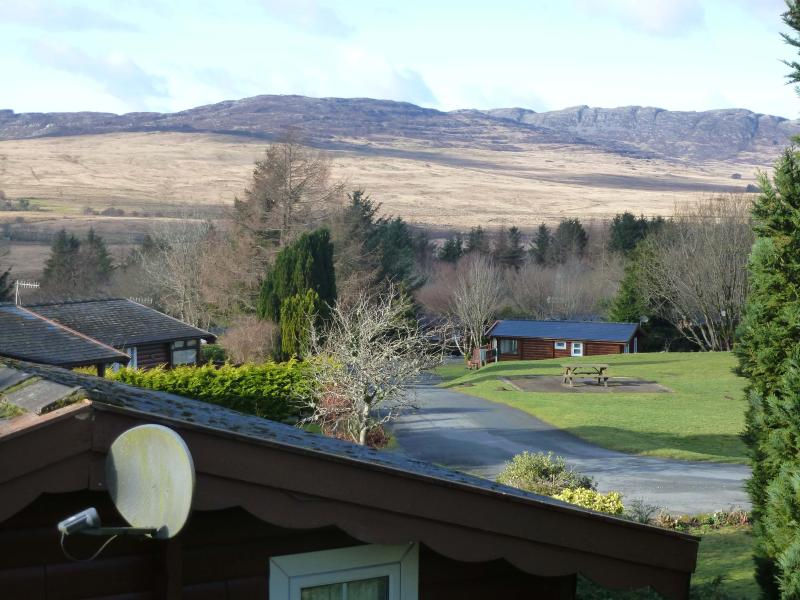 View from cabin across to The Rhinog Mountains with children's play area to right.