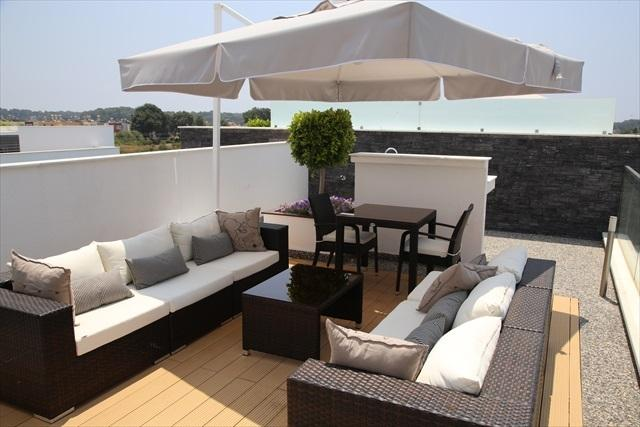 Sunny roof terrace with shade