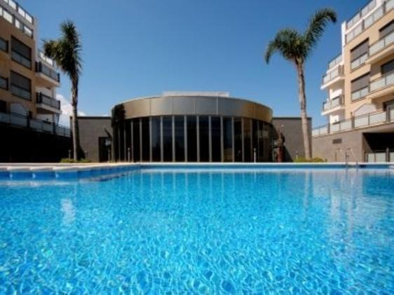 Oliva Nova Penthouse Apartment Indoor and Outdoor pool, Roof terrace overlooking sea and golfcourse.