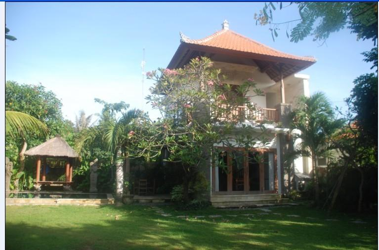 Our Villa, behind the Cambodia tree with Pool & thatched Bale, set in a large quiet tropical Gar