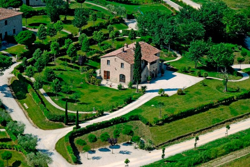 the villa and its garden view from an helicopter