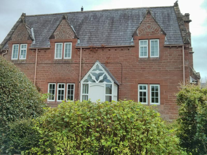 The  front of the Old School House.  There is a mature garden around the Old School House