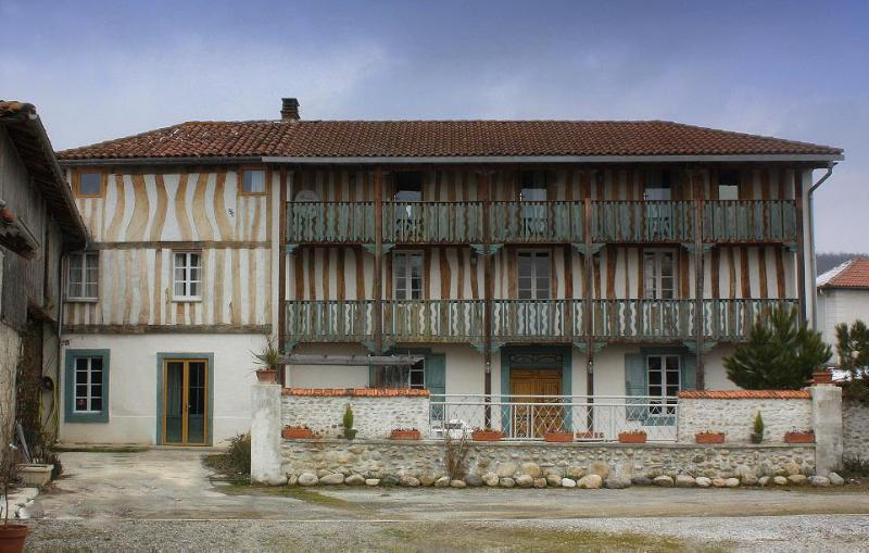 Front of house with restored balconies, overlooking the Pyrenees