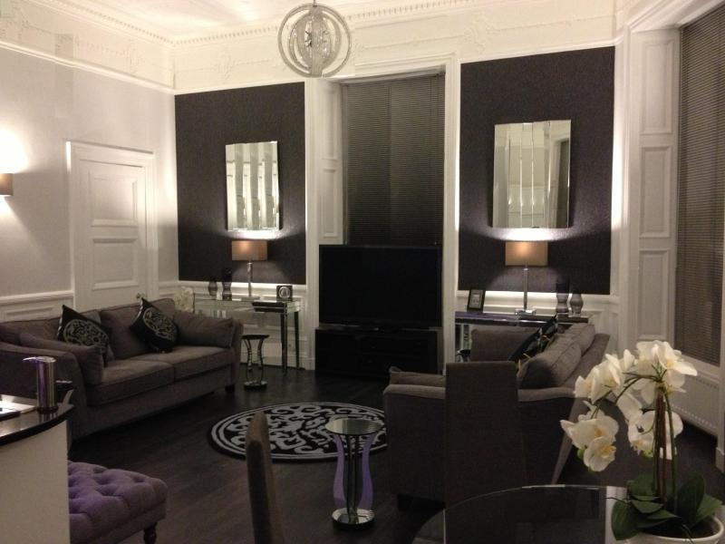 Luxury designer style open plan living, M+S Sofas (one of which is a double bed - with M+S linen)