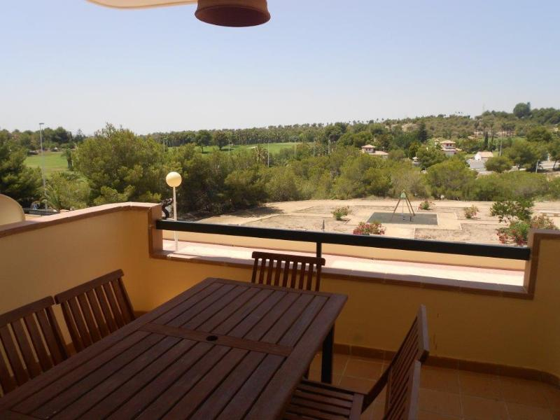 balcony with view over golf course towards the Med