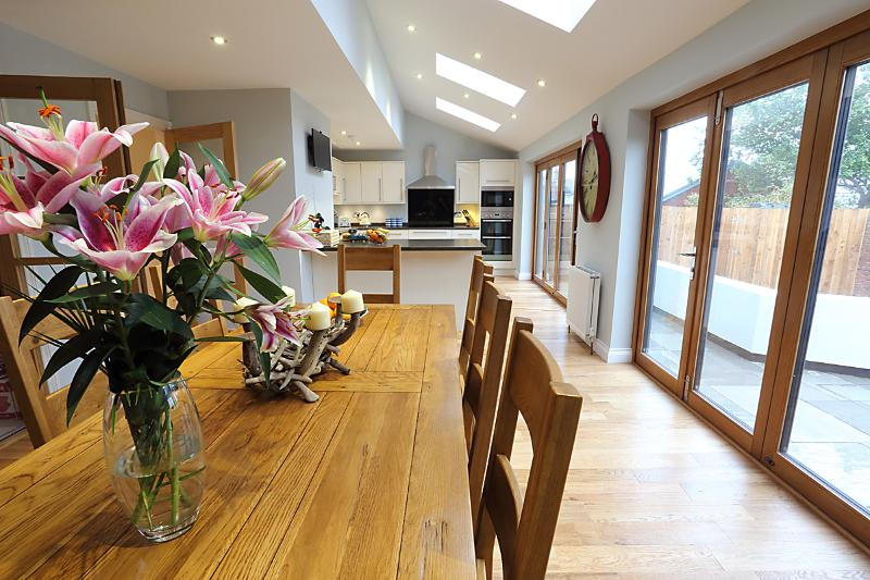 Large modern Kitchen/Diner with bi-folding doors leading straight out to sunny garden
