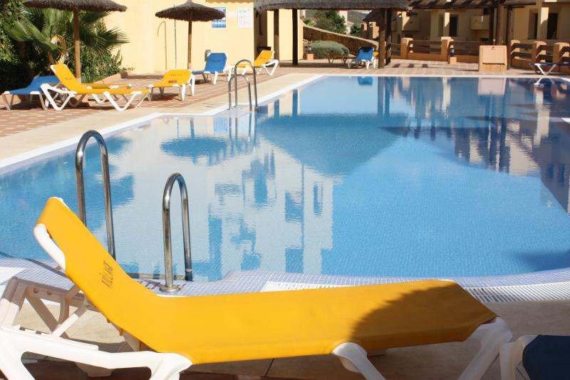 Lounging by one of the five pools. Impeccably maintained pools amongst beautiful landscaped gardens.