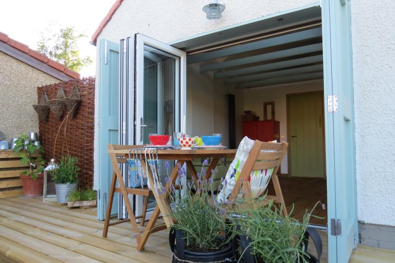A south facing deck accessed by bi-folding glass doors gives lots of dining options.