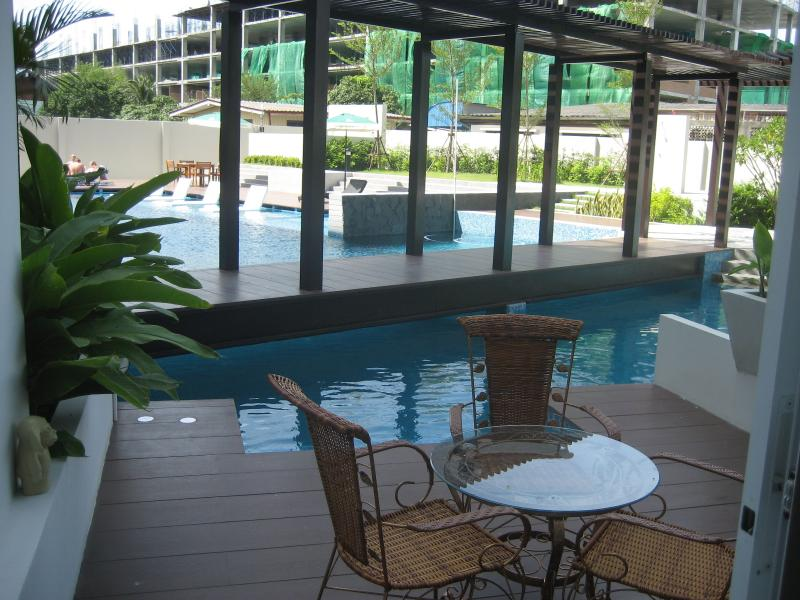 your privat terrace at the beautiful swimmingpool. Your own chairs always available