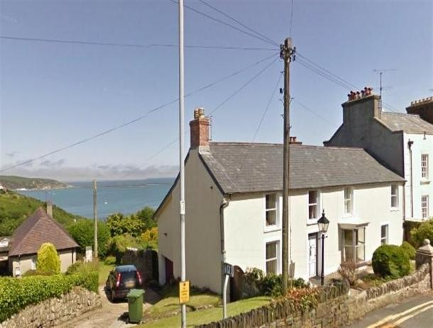 Rock house with view over Fishguard