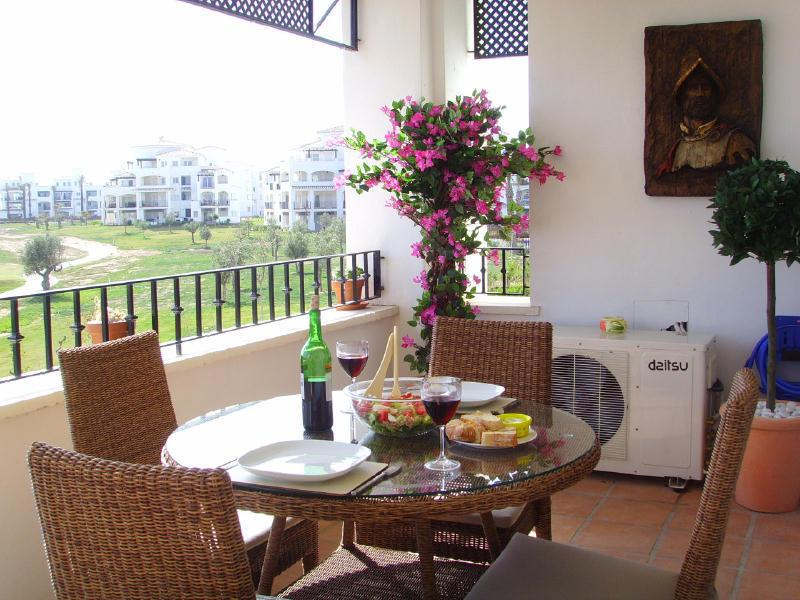 The Apartment Alfrasco dining overlooking the 8th fairway