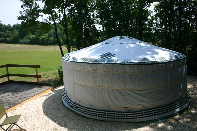 Your Yurt and decking area with table, chairs & BBQ
