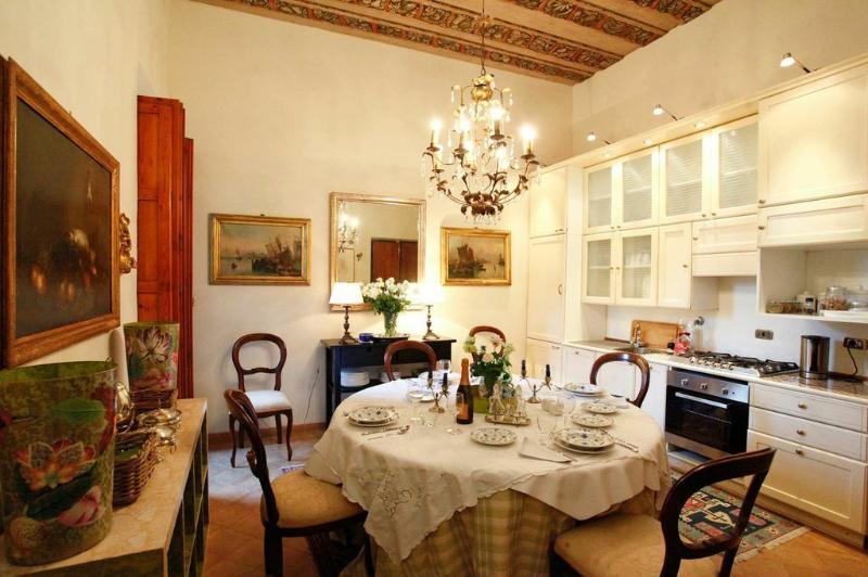 Elegant dining room with kitchen - old master paintings and antiques throughout