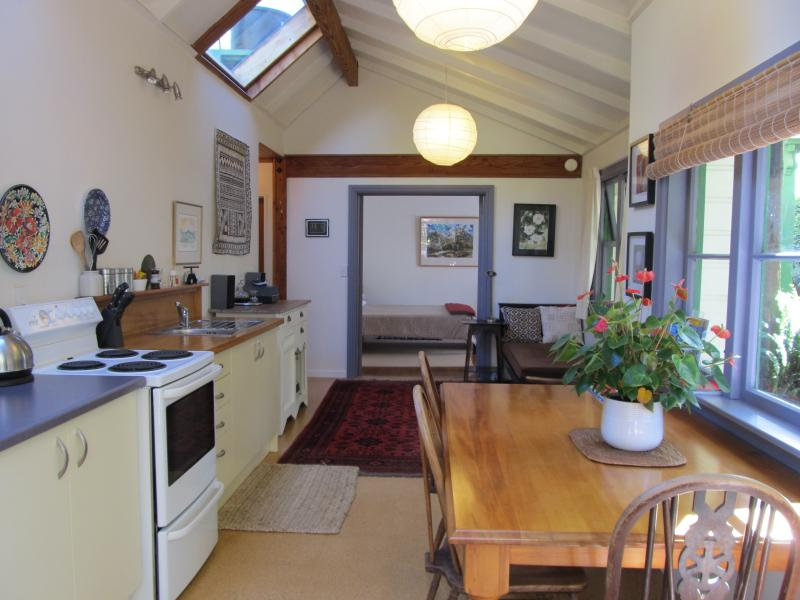 The kitchen/living area which has french doors leading to the  courtyard and garden.