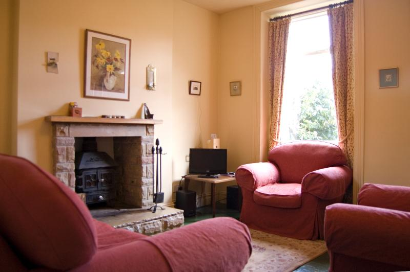 Comfortable sitting room with stove and with TV/DVD, CD/radio