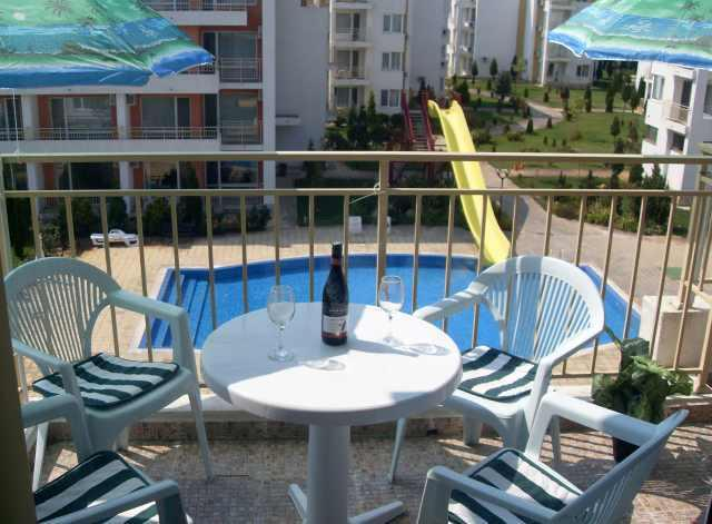 Our Lovely Penthouse apartment has a beautiful balcony overloooking the pool...Cheers.