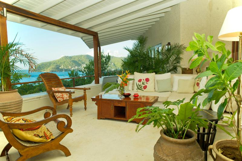 The coral stone terrace with sweeping views of the sea , the perfect place to watch the sun set