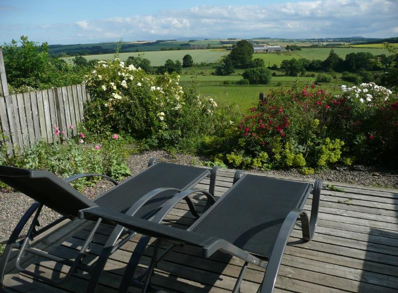 Decking and sun loungers in front of Garden Bnk Cottage