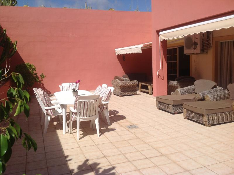 Large terrace with lounge area, dining area and luxury sun loungers also 2 awnings for shade