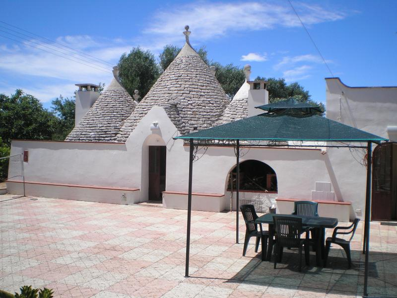 Trullo from the sun terrace and gardens, with the gazebo and al fresco dining area