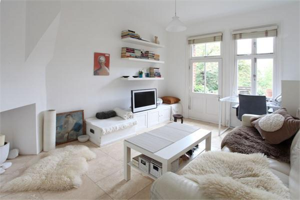 The living room - light and airy is the theme! The door leads to the balcony overlooking the square