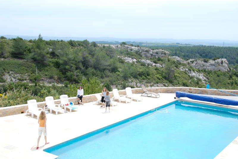 A large 15 x 6m pool with views of the Mediterranean Sea & Pyrenees Mountains in the distance.