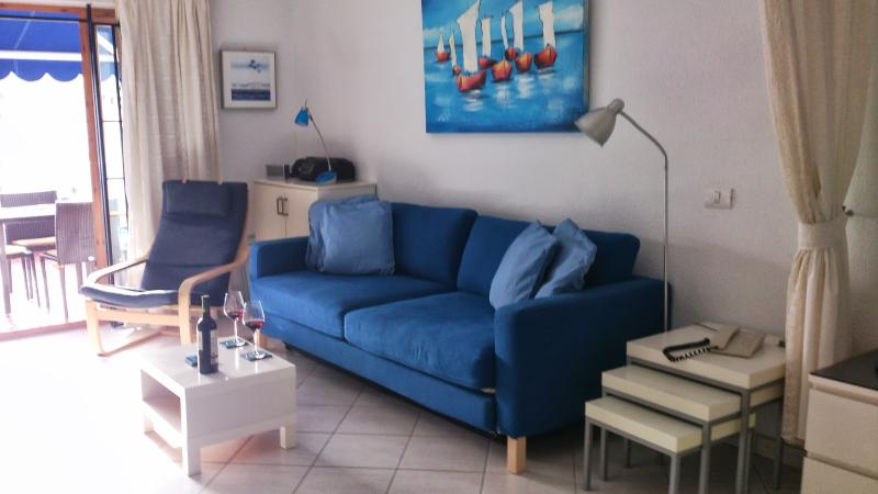 Large comfortable sofa which easily converts to a bed for additional sleeping