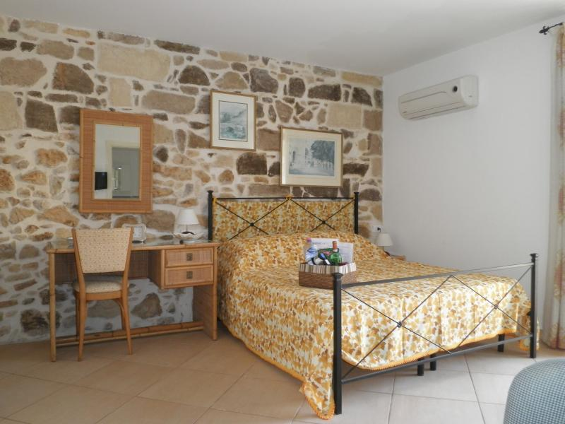 The bed - showing the stone wall