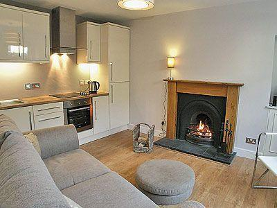 Contemporary cottage central quiet  location. Free wifi and real log fire.  Peebles .