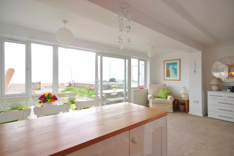 Panoramic views of the sea from our open plan kitchen diner.