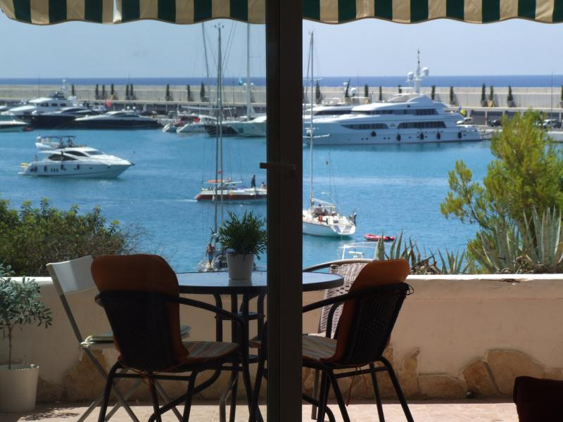 View from lounge to patio, marina and sea beyond
