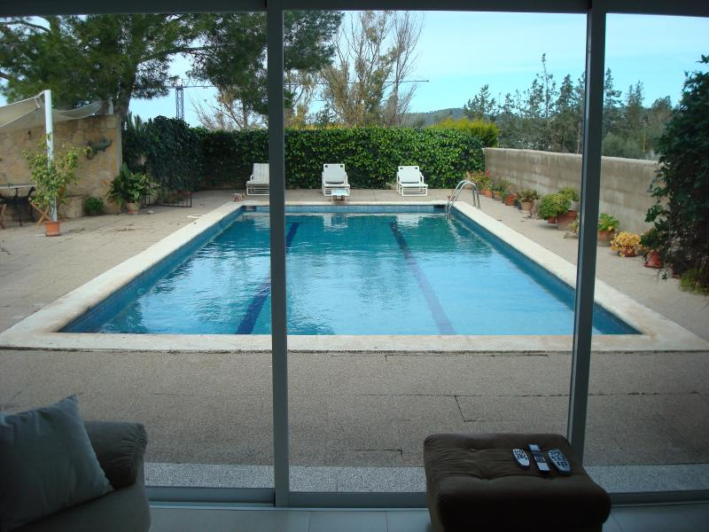Pool view from lounge in Main double bedroom