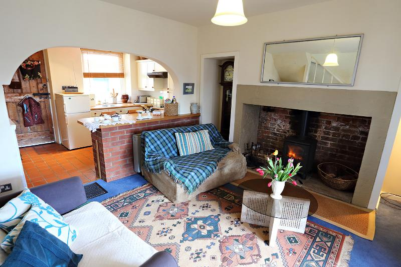 Relax in the cosy sitting room with the log burner