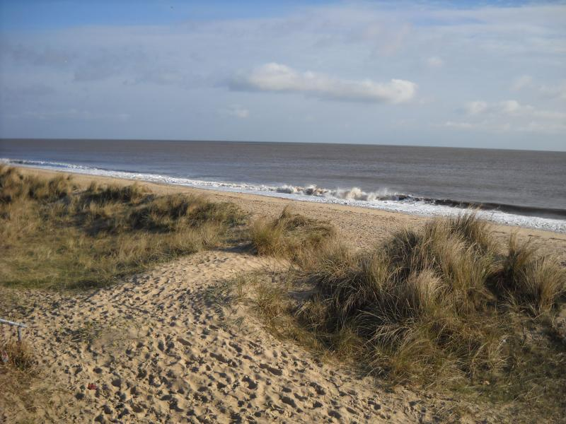 Walk barefoot onto the sandy beach right outside your door..or watch the sea from the living room!