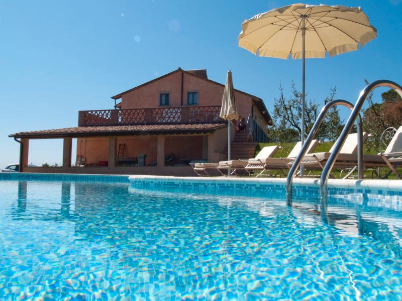 Private swimming pool and a glass of wine ...the best relax in Toscany