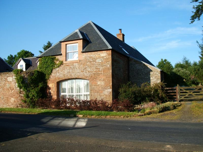 Cottage built from local red sandstone. The original building is over 160 years old.