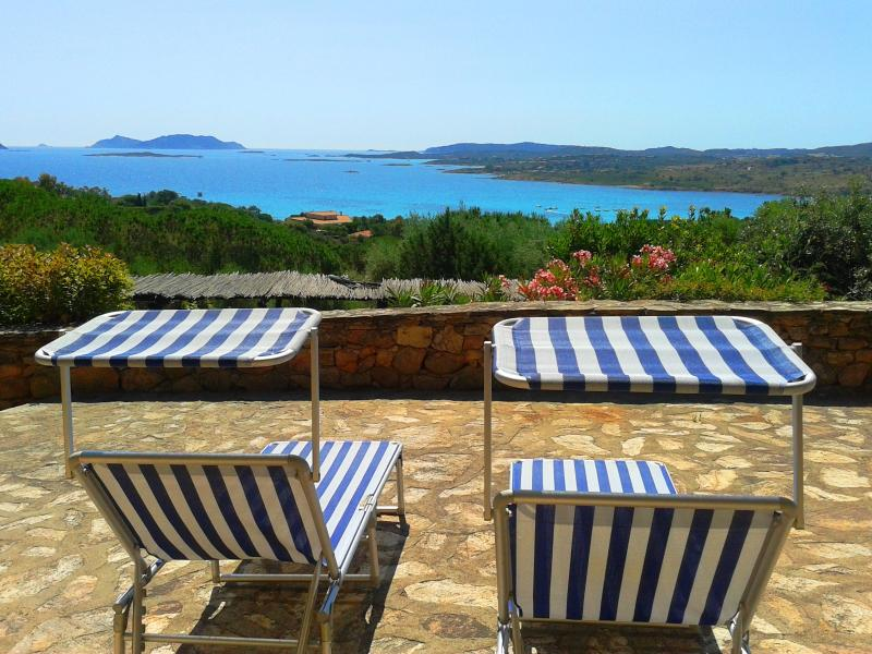 Sun loungers from the property with sea view