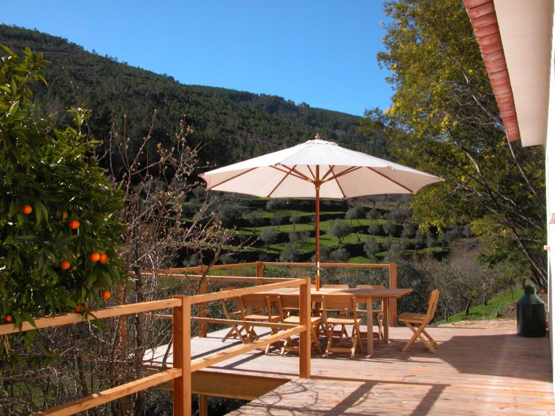 Sun deck with dining area and views up the valley.