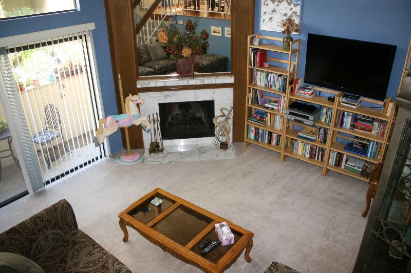 Living/entertainment. High ceiling, gas fireplace, patio, large screen TV with 500 channels.