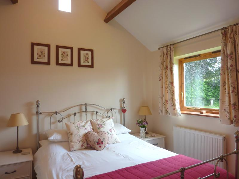 Puddings Barn Bedroom with a Pewter frame King Size Bed