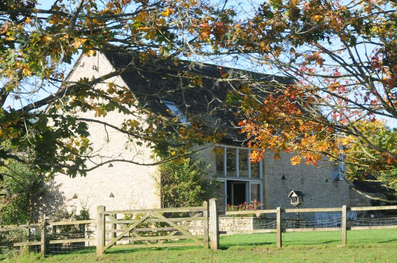 Heath Barn from the pony's field with autumn colours.